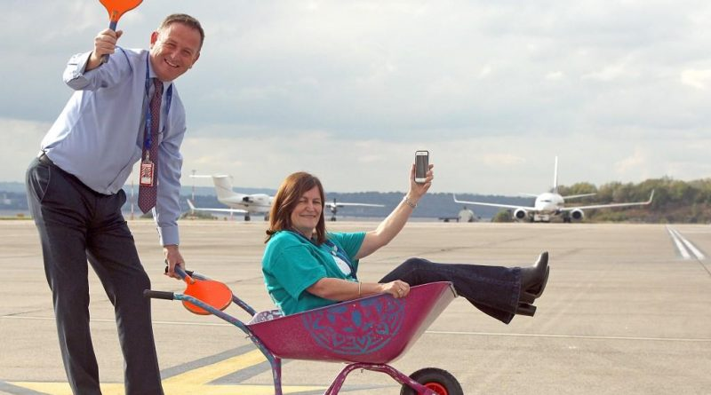 Liverpool John Lennon Airport Loves Event to support Alder Hey Childrens Charity. The launch of a digital app to aid the experience of patients and familes at the hospital. Pictured l to r: Andrew Cornish (LJLA Chief Executive) with Carol Dutton (LJLA HR Director). Photo by Ian Cooper